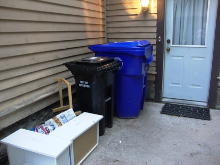 Reduce (small garbage bin), recycle, and repurpose - foreground