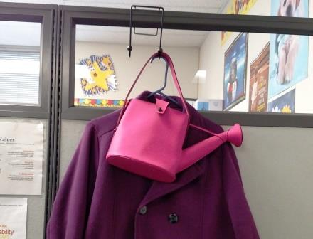 Pink Purse hanging in cubicle